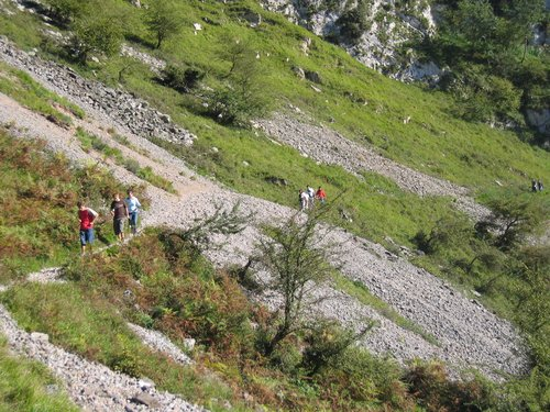 Hikers crossing one of the srcees