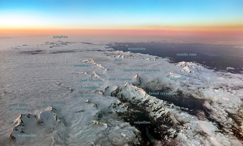 Aerial view of Pennine Alps at dusk - with caption