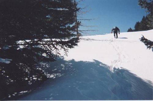 Jesus hiking the steep snow