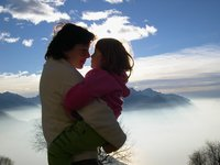 My two lovely girls above a cotton sea-clouds